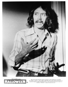 John Carpenter on the set of Halloween in a rare publicity shot for the film.
