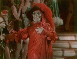 The Phantom appears at the Grand Masque Ball, dressed as the Red Death from Edgar Allan Poe's short story